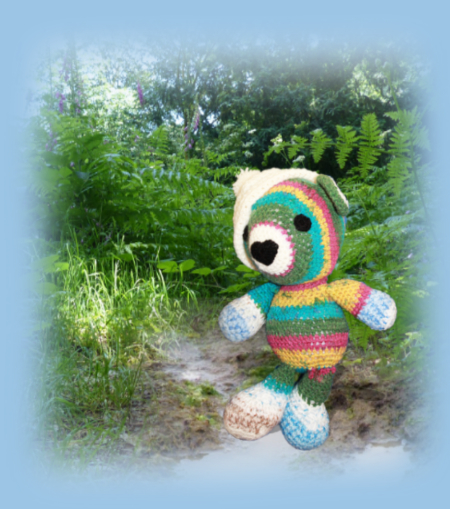 Splosh, one of our loveable crochet teddies from the Jolly Jangle family